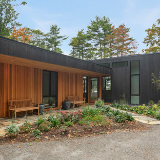 Example of a mid-sized mountain style black one-story wood exterior home design in Portland Maine