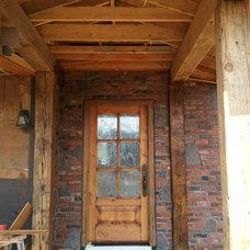 Traditional Exterior by Go brick and stone masonry