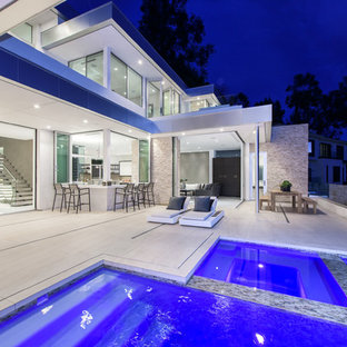 Inspiration for a contemporary white three-story stucco exterior home remodel in Los Angeles