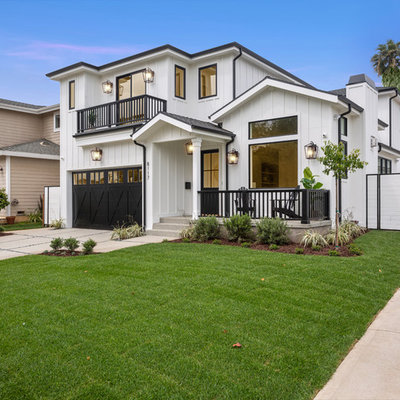 Transitional white two-story exterior home photo in Los Angeles