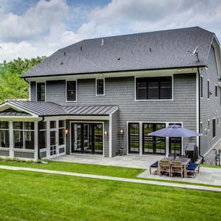 Large arts and crafts gray three-story concrete fiberboard exterior home photo in DC Metro with a clipped gable roof