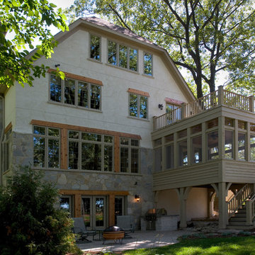 Rear Elevation of Stone and Stucco French Country Vacation Home Featuring Screen