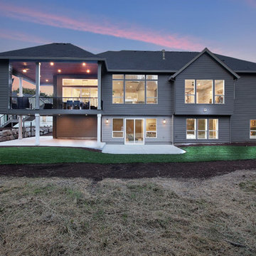 Rear of Home at Dusk - The Genesis - Family Super Ranch with Daylight Basement