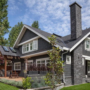 Mid-sized ornate gray two-story mixed siding exterior home photo in Vancouver with a shingle roof