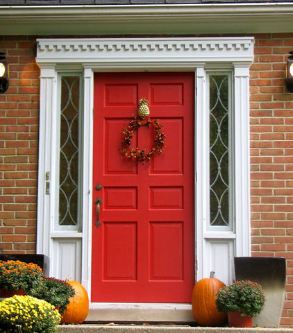 traditional exterior Red Front Door With Pineapple Knocker