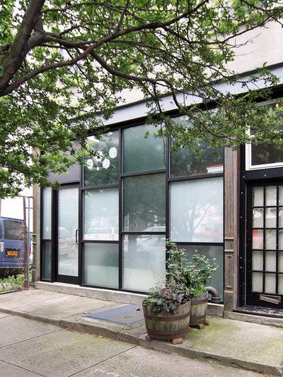 Contemporary Exterior by KIMOY Studios