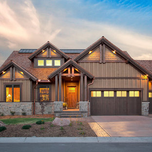 Mountain style wood exterior home photo in Salt Lake City