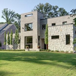 Example of a minimalist stone exterior home design in Atlanta