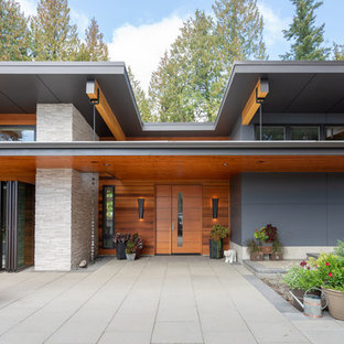 Inspiration for a contemporary blue two-story wood house exterior remodel in Seattle with a shed roof and a metal roof