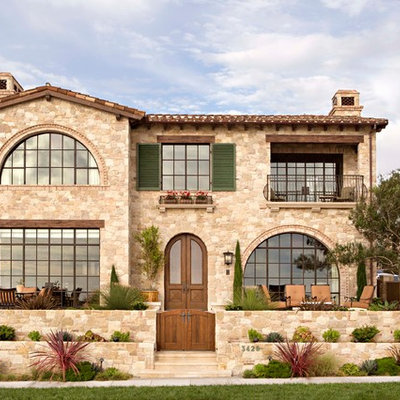 Inspiration for a mediterranean two-story stone exterior home remodel in Los Angeles