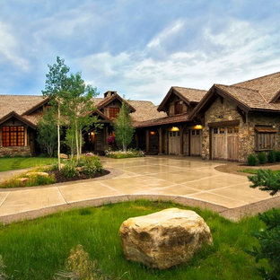 Huge rustic multicolored one-story mixed siding house exterior idea in Denver with a shingle roof and a shed roof