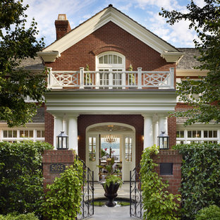 Example of a large classic red two-story brick exterior home design in Seattle with a shingle roof