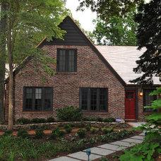 Rustic Exterior by Burton Builders