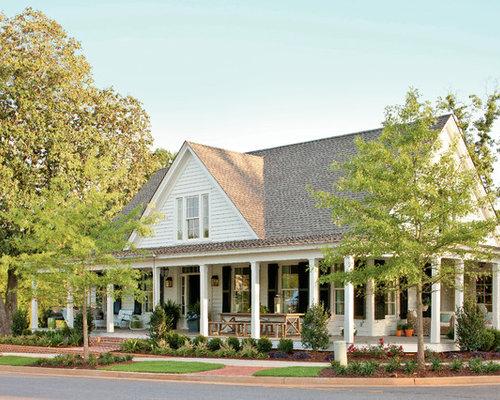 farmhouse with wrap around porch houzz