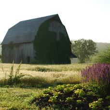 Farmhouse Exterior by Rost, Inc.