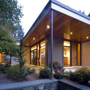 Example of a trendy wood exterior home design in Boston