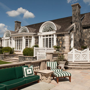 Traditional stone exterior home idea in New York
