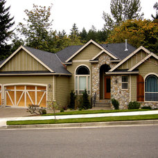 Traditional Exterior by Duke Construction Inc