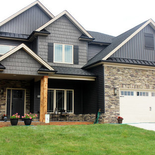 Inspiration for a mid-sized timeless gray two-story vinyl exterior home remodel in Other