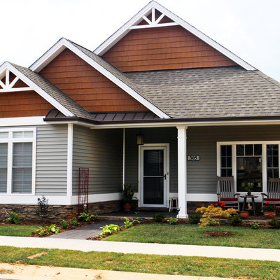 Small traditional gray two-story vinyl exterior home idea in Other