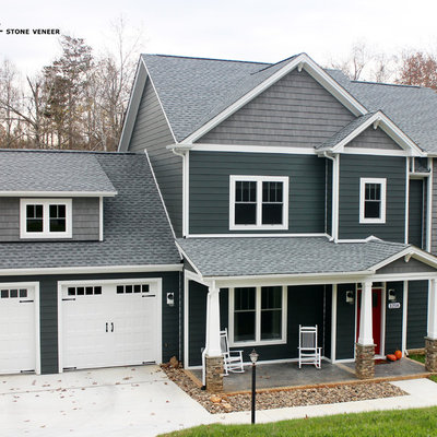 Inspiration for a mid-sized timeless gray two-story concrete fiberboard exterior home remodel in Other