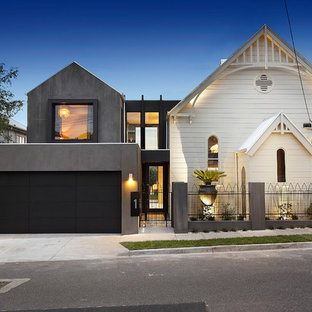 This is an example of a contemporary two-storey white exterior in Melbourne with mixed siding and a gable roof.