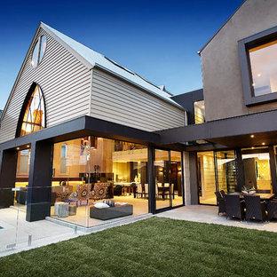 Trendy concrete exterior home photo in Melbourne