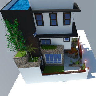 Foto de fachada blanca, asiática, pequeña, de tres plantas, con revestimiento de hormigón, tejado de un solo tendido y tejado de metal