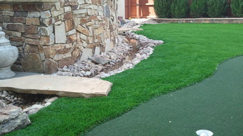 Residential synthetic putting green with water feature