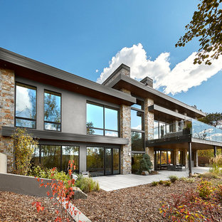 Inspiration for a large contemporary gray two-story mixed siding exterior home remodel in Calgary