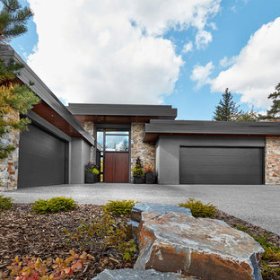 Example of a large trendy gray two-story mixed siding exterior home design in Calgary
