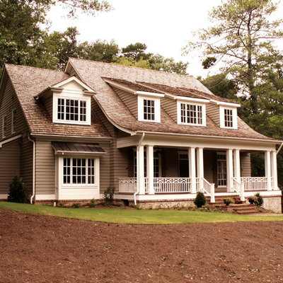 Inspiration for a mid-sized timeless gray two-story vinyl exterior home remodel in Atlanta with a shingle roof