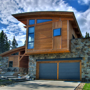Example of a trendy stone exterior home design in Denver