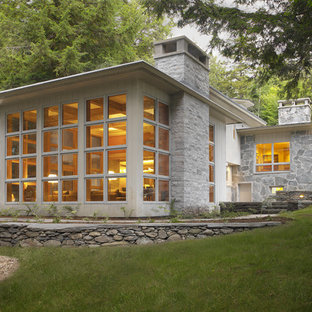 Trendy one-story stone exterior home photo in Burlington