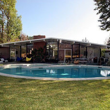 Midcentury Exterior by Himes Miller Design Inc.