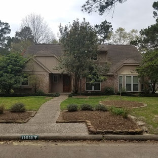 Inspiration for a mid-sized timeless beige two-story mixed siding exterior home remodel in Houston with a shingle roof