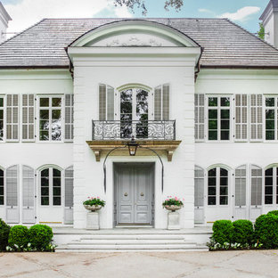 Large traditional white two-story house exterior idea in Nashville with a hip roof and a shingle roof