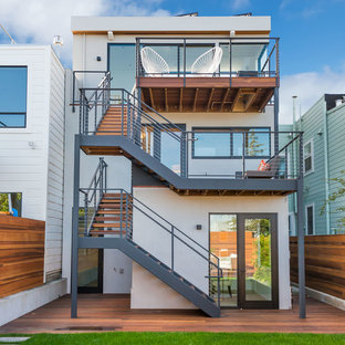 Inspiration for a mid-sized contemporary gray three-story stucco flat roof remodel in San Francisco