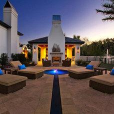 Mediterranean Exterior by Maison de Reve Builders LLC