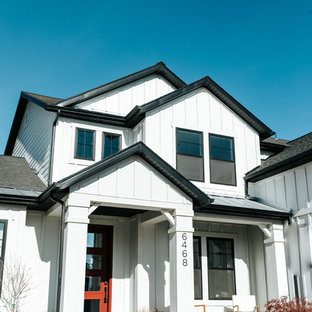 Country white two-story townhouse exterior idea in Salt Lake City with a mixed material roof