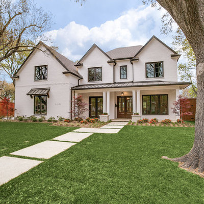 Mid-sized transitional white two-story stucco exterior home idea in Dallas with a metal roof