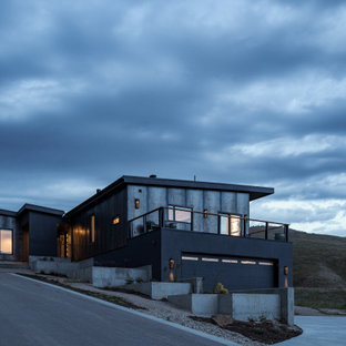 Inspiration for a small modern two-storey grey house exterior in Boise with metal siding and a metal roof.