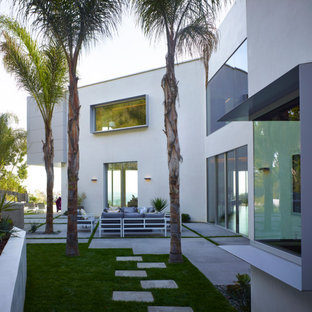 Inspiration for a large modern three-story mixed siding exterior home remodel in Los Angeles