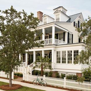 Traditional white three-story exterior home idea in Atlanta