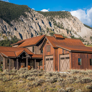 Rustic brown two-story mixed siding exterior home idea in Denver with a metal roof
