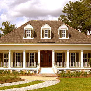 Example of a classic wood exterior home design in New Orleans