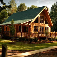 Rustic Exterior by Southland Log Homes
