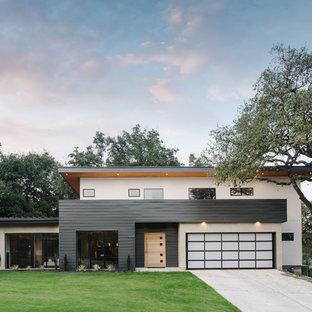 Inspiration för stora moderna flerfärgade hus, med två våningar, platt tak och blandad fasad