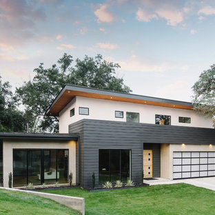 Large modern multicolored two-story mixed siding exterior home idea in Austin with a shingle roof
