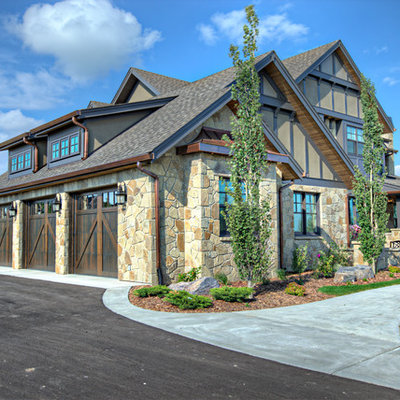Inspiration for a timeless mixed siding exterior home remodel in Calgary